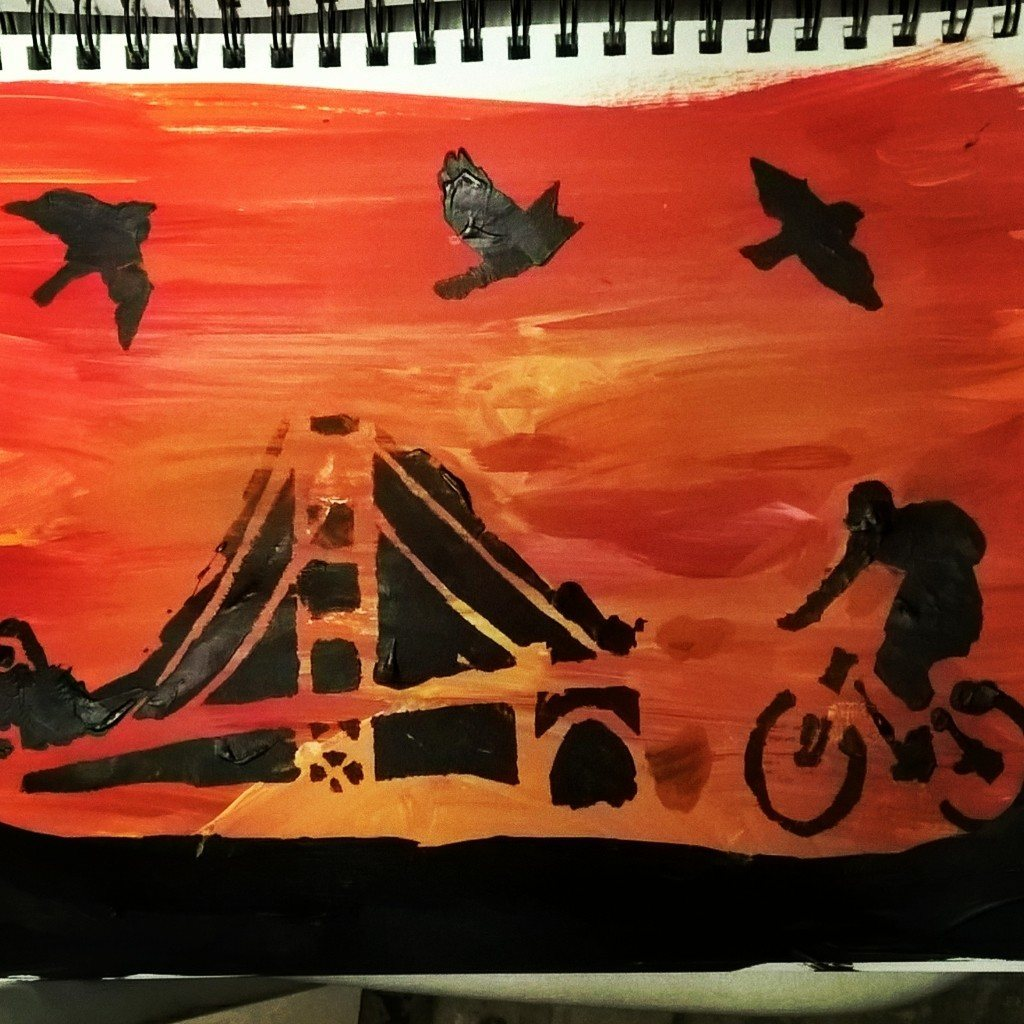 sunset sky with silhouettes of bridge and bike and birds