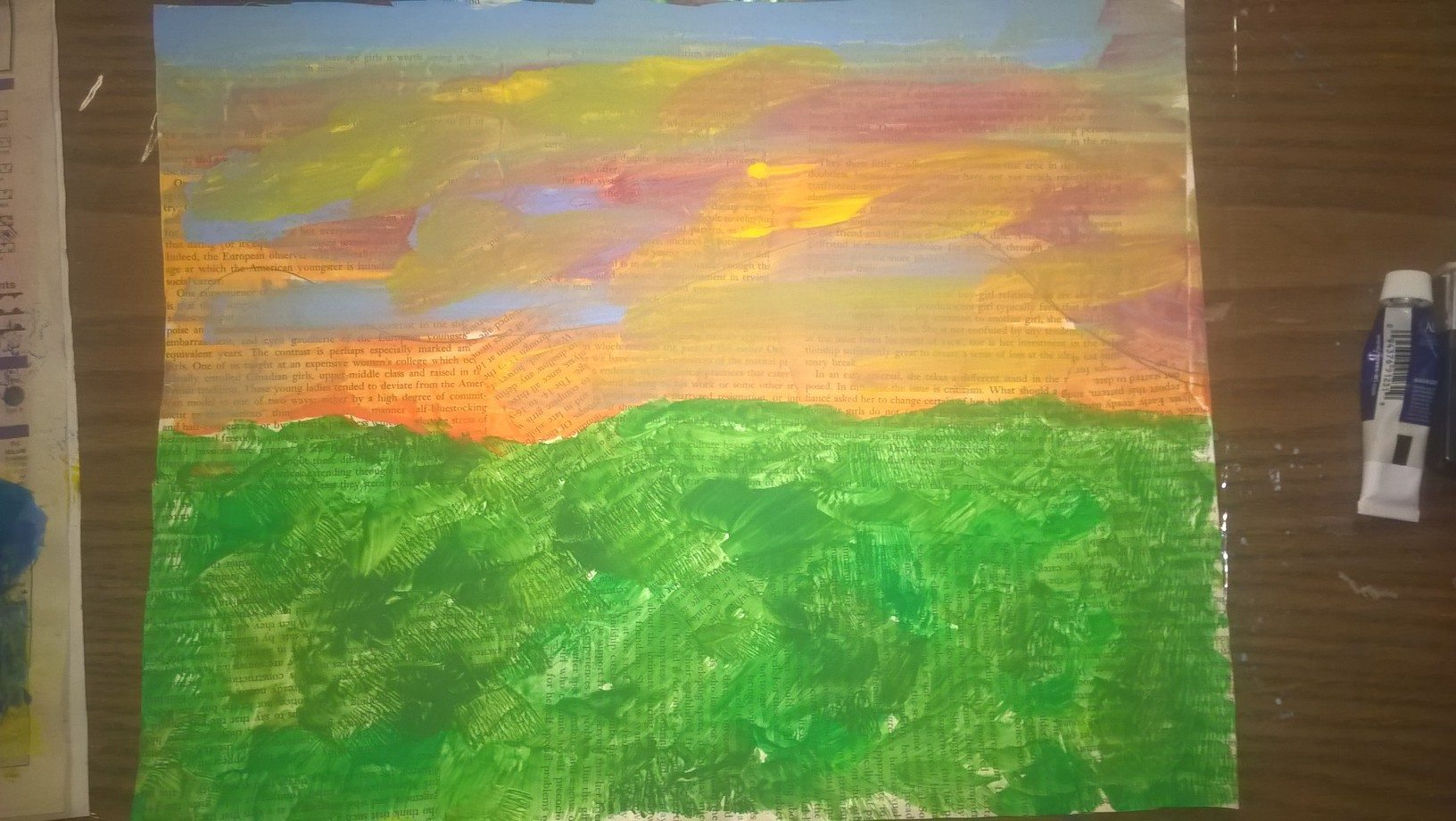 painted sunset and grass background over newspaper background