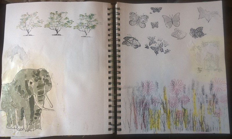 journal spread with traced elephant and nature stamps