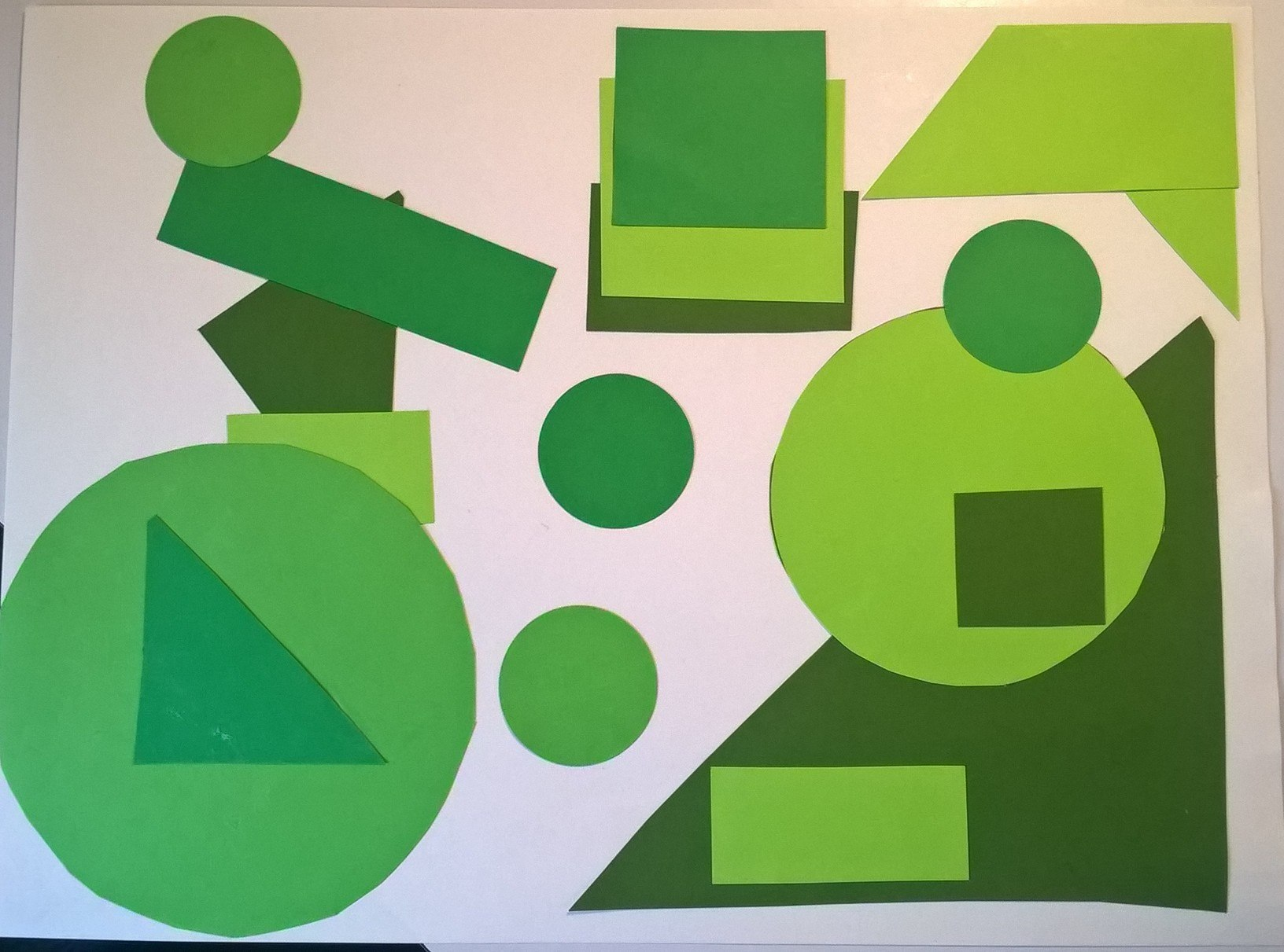 shape collage using green geometric shapes