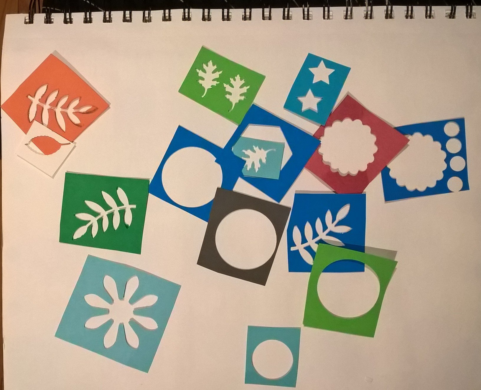 assortment of small stencils made with craft punches
