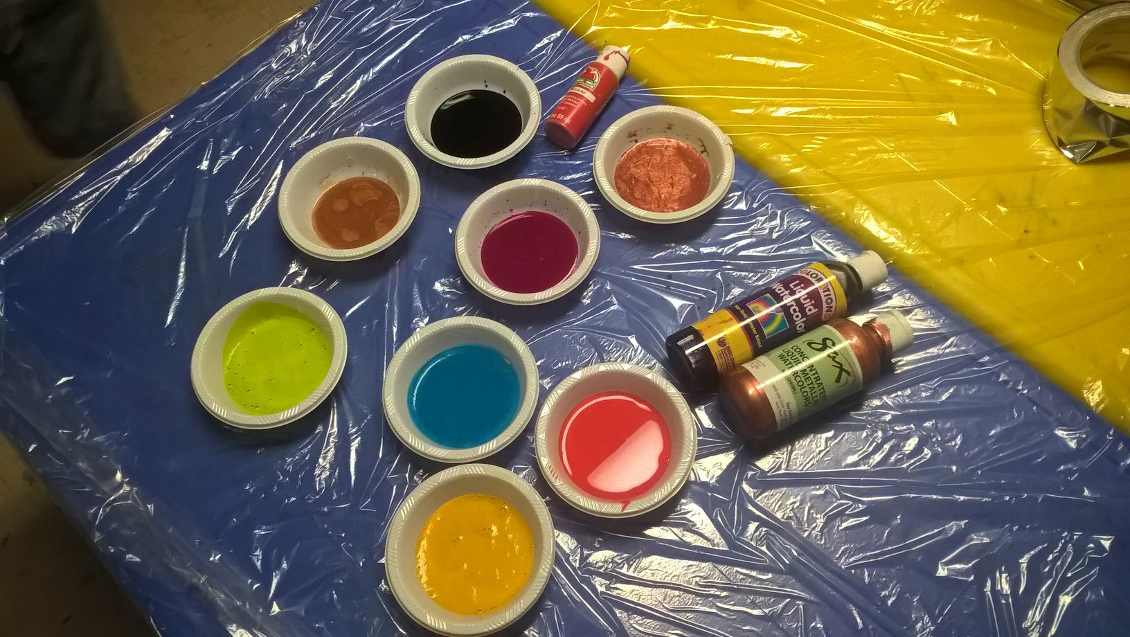 watercolors and acrylic paints in bowls
