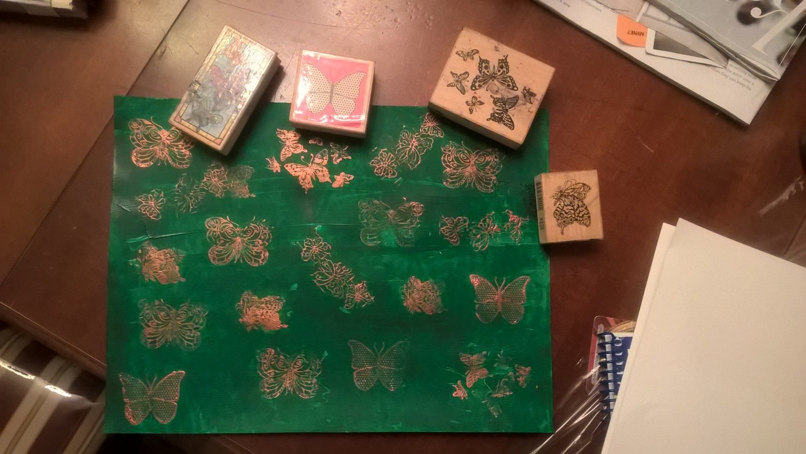 gold stamped butterflies over green background