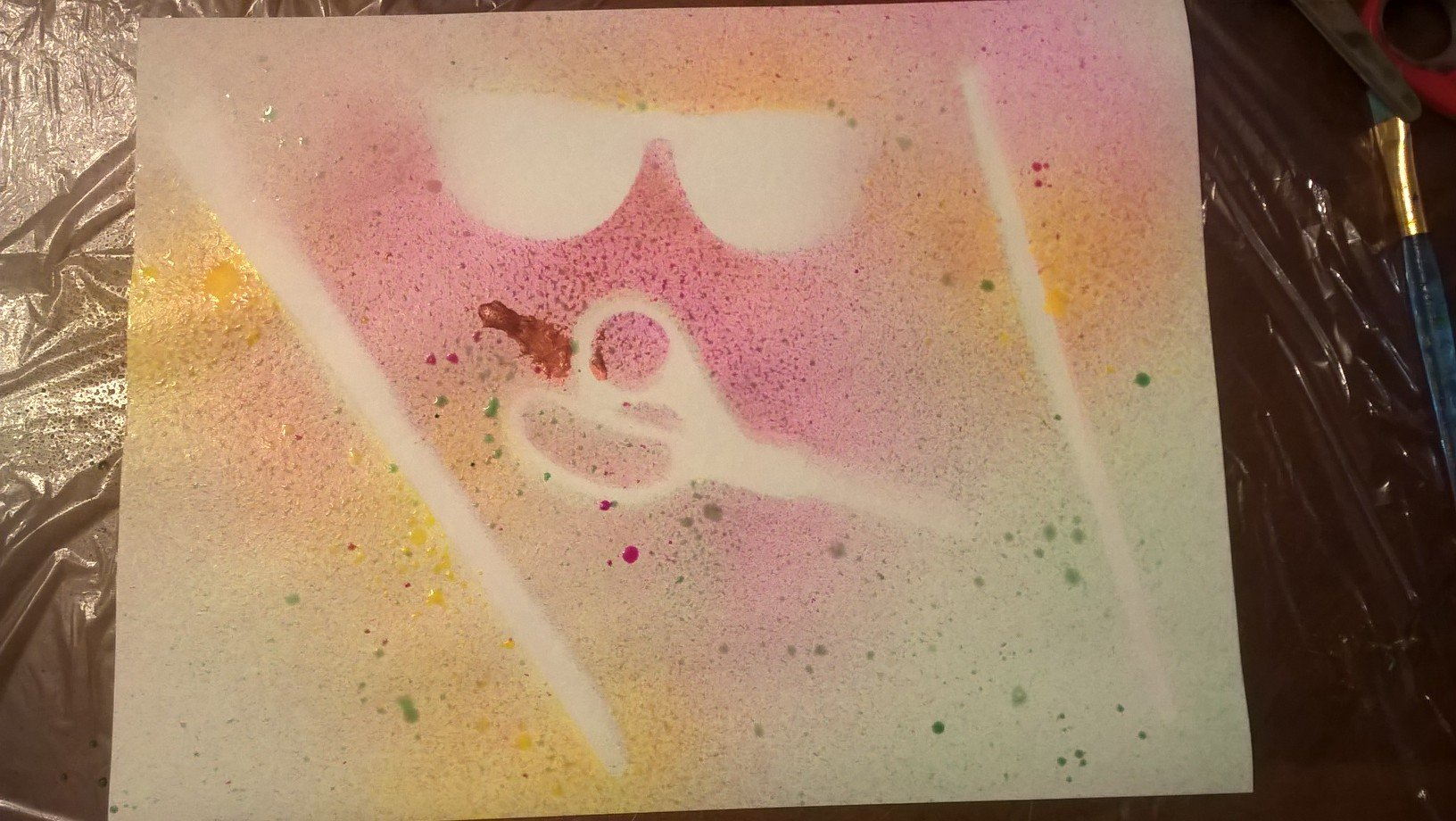 spray over scissor, glasses and paintbrush