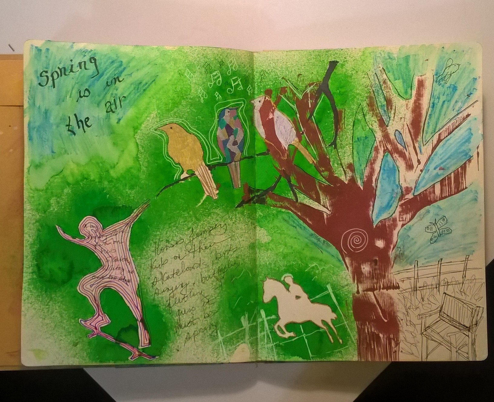 mixed media art with stenciled images of tree horse and birds