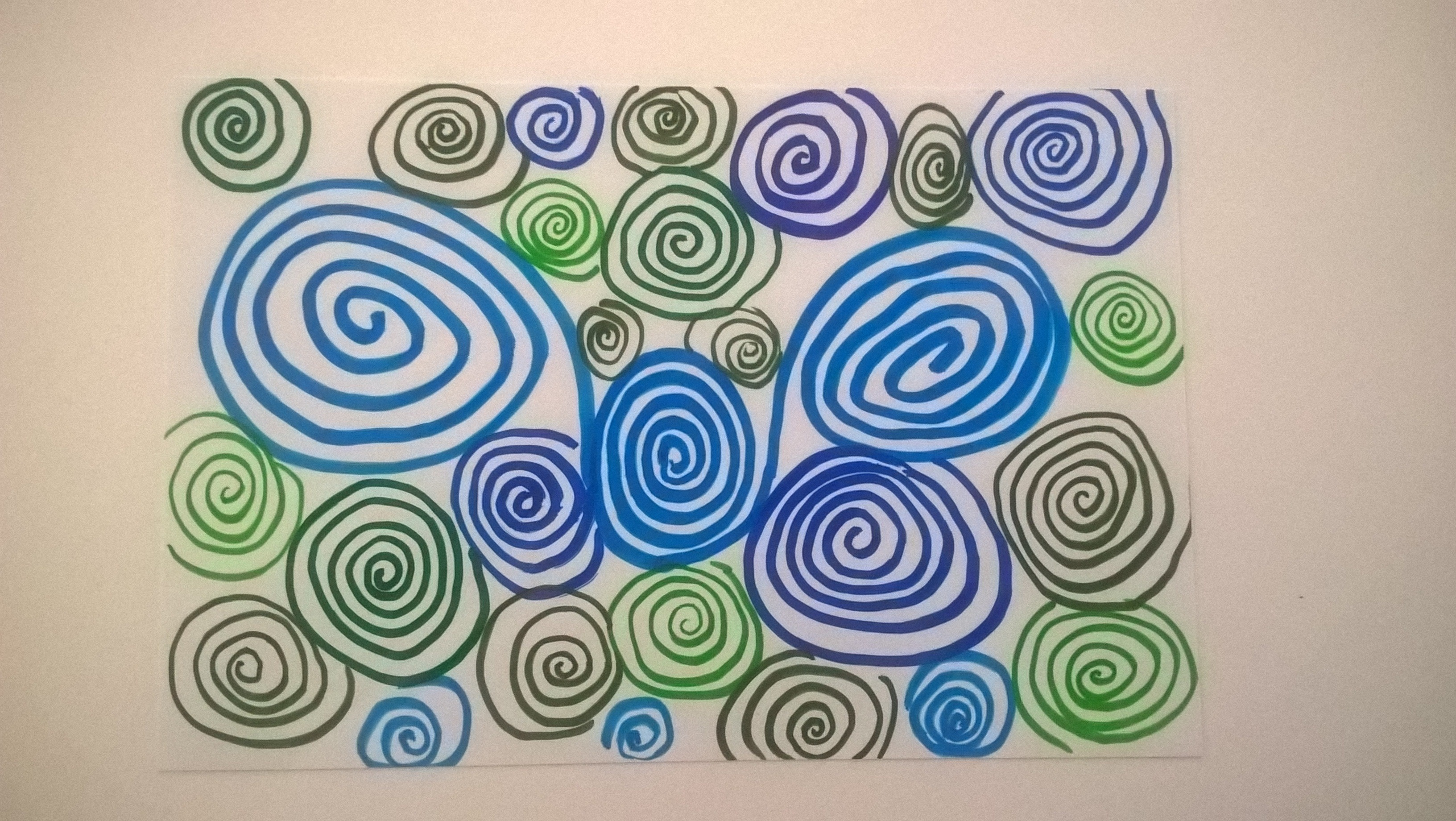 doodled spirals on photo paper