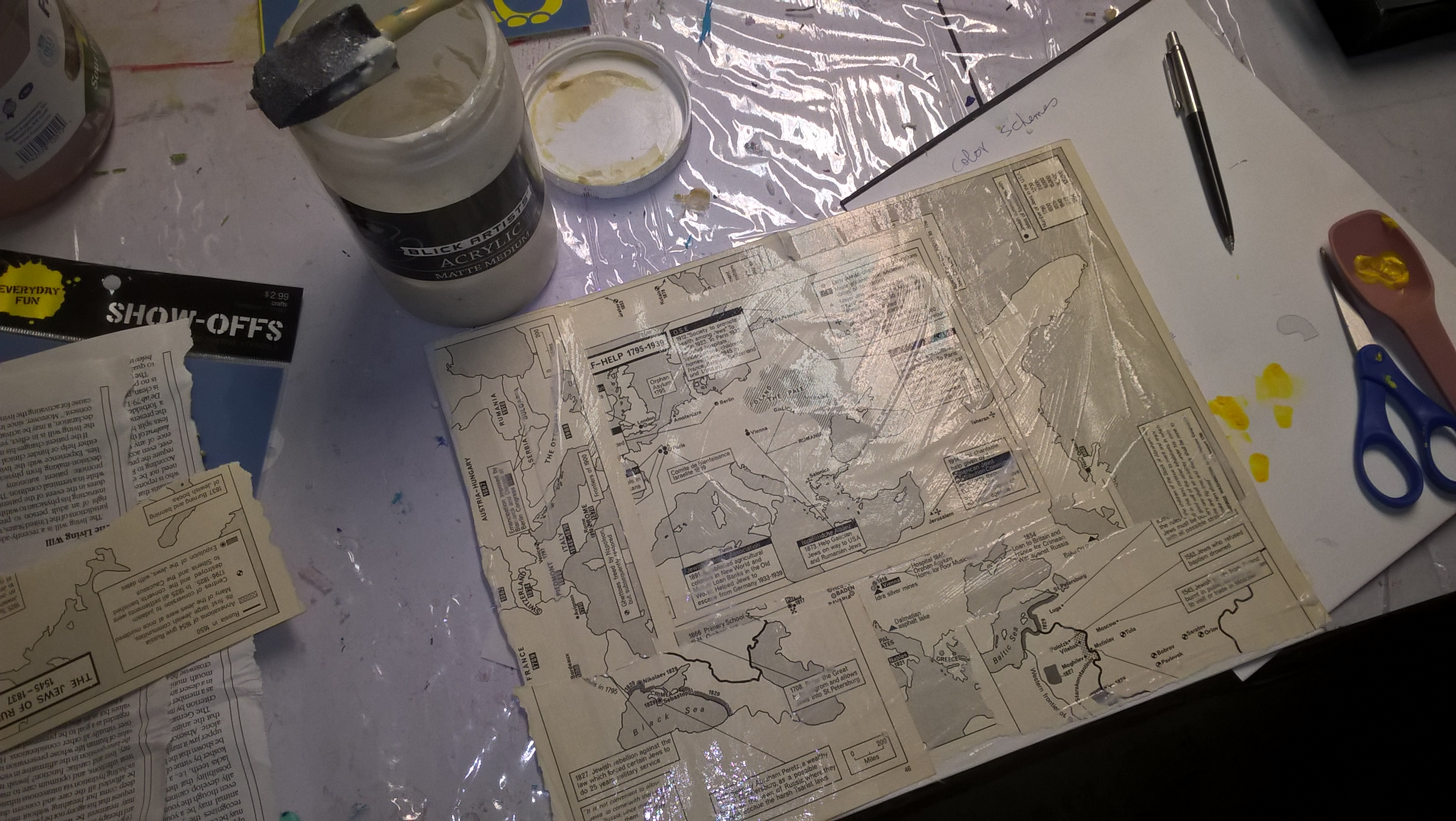 old map pages covering canvas