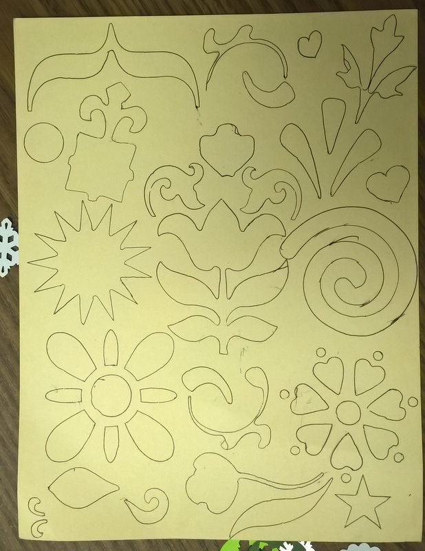 page full of designs created with stencils for coloring