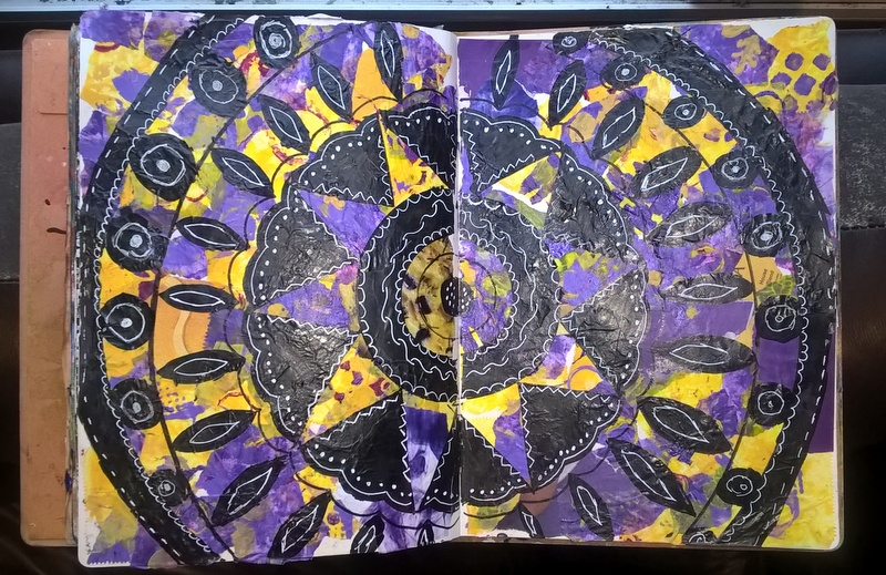 mandala in journal page with ripped deli paper and black marker