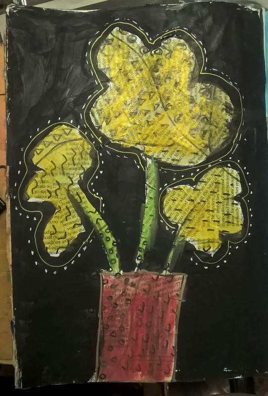flowers in vase over newspaper
