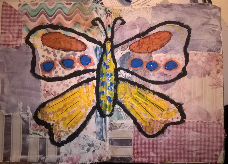 mixed media art with fabric background and butterfly painted on top