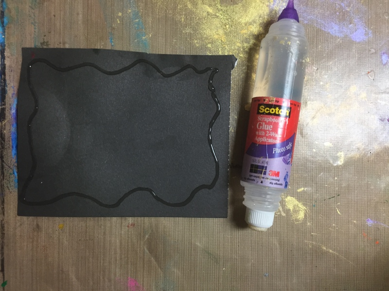 liquid glue and black paper