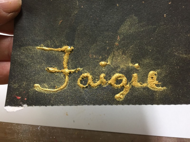 word covered with pigment powder