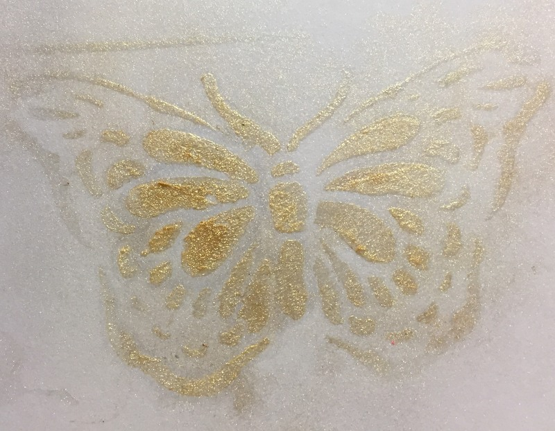 gold pigment powder through  butterfly stencil